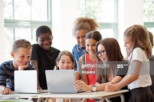 Schoo teacher and her pupils